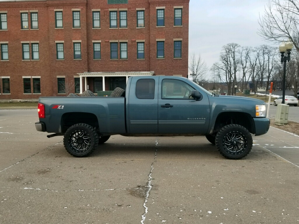 Truck with Rough Country 6 inch lift kit installed and mud tires
